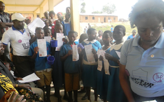 Children, teachers and parents in Cameroon stand #UpForSchool