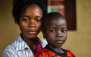 Teenage girls missing out on school to care for Ebola orphans
